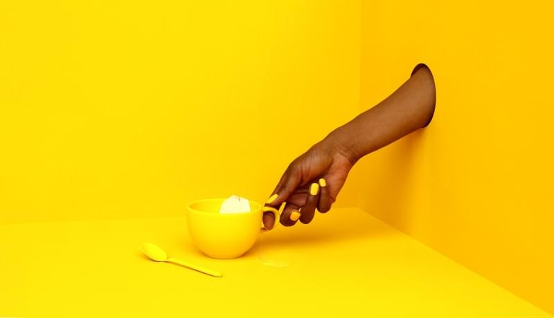 Cup of tea on yellow background